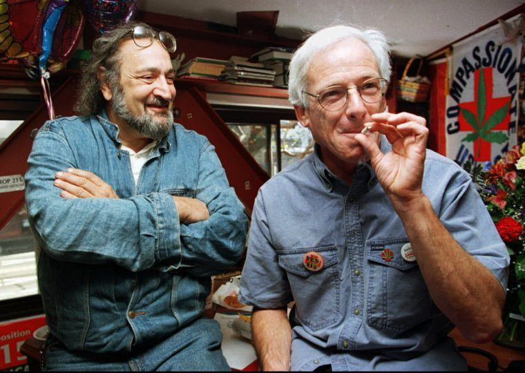 Cannabis activists Jack Herer and Dennis Peron smoking a joint.