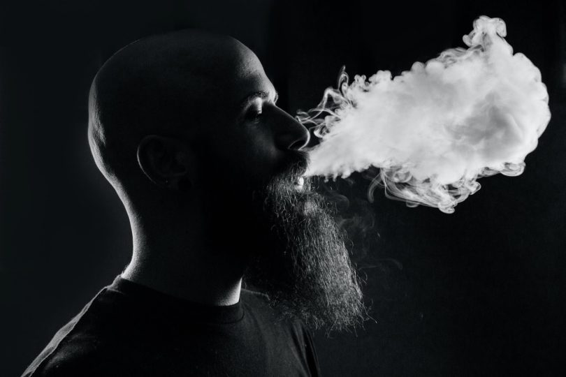 Man blowing out vapor